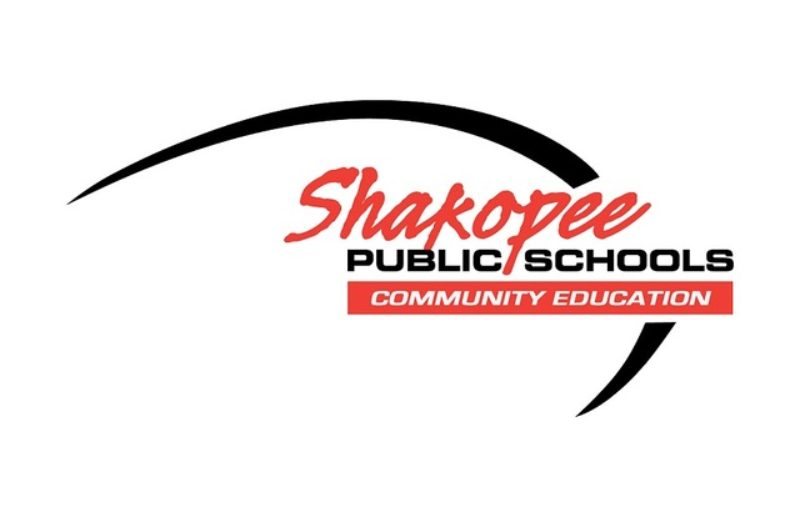 Logo of Shakopee Public Schools Community Education in red and black lettering with a black arch behind the words