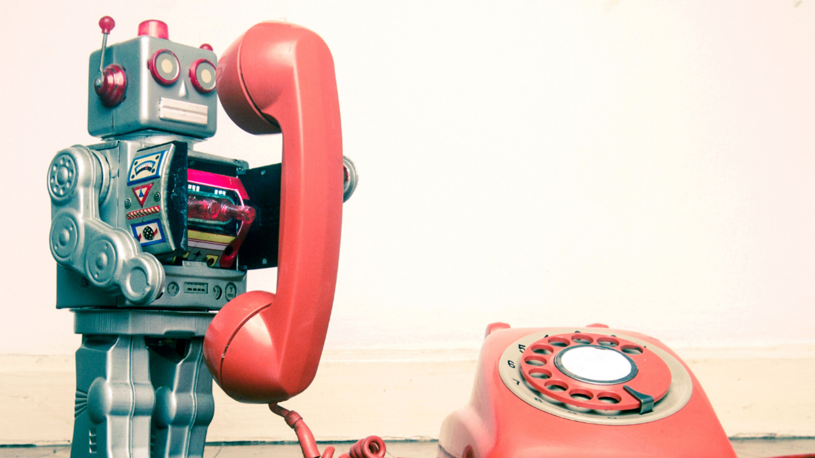 Talking toys including a robot talking on an old rotary phone