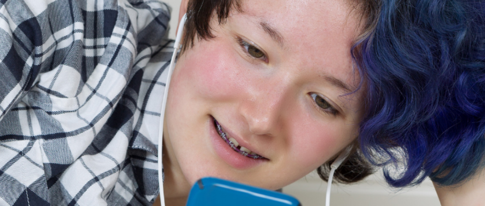 Teenager looking at phone