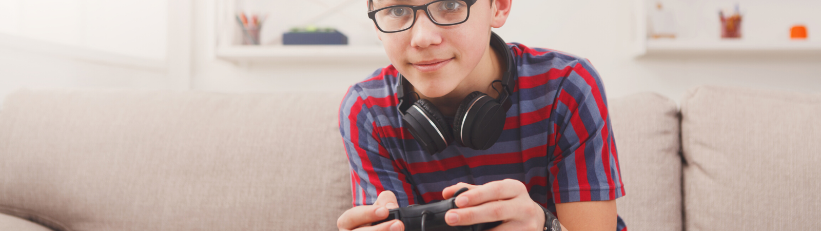 Child playing video games on the couch