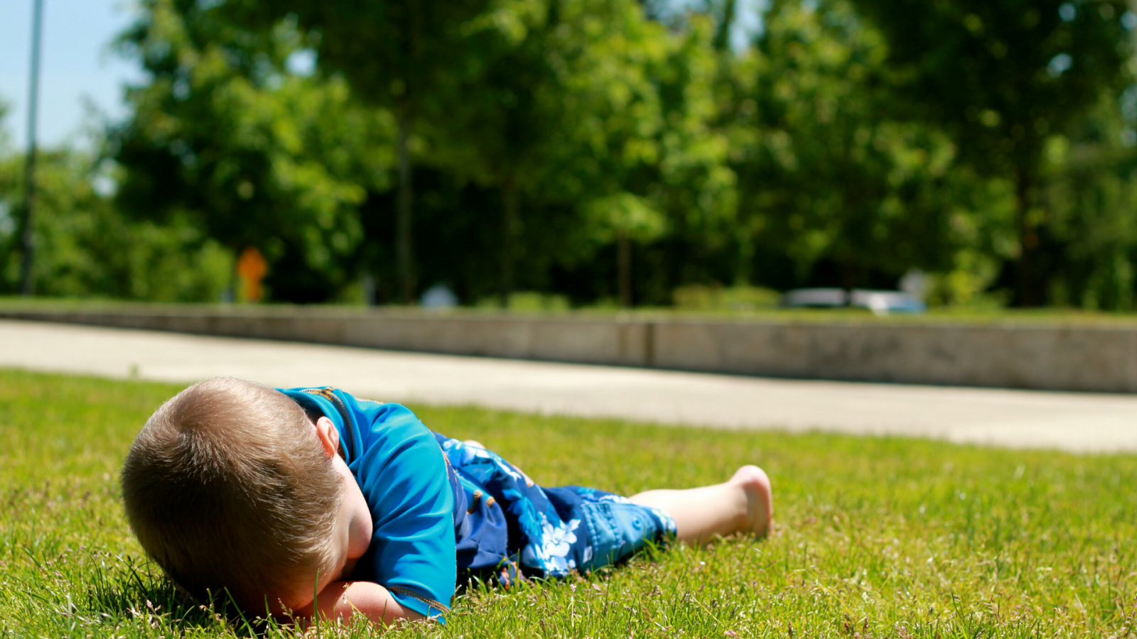 A child's behavior causing him to collapse on the grass.