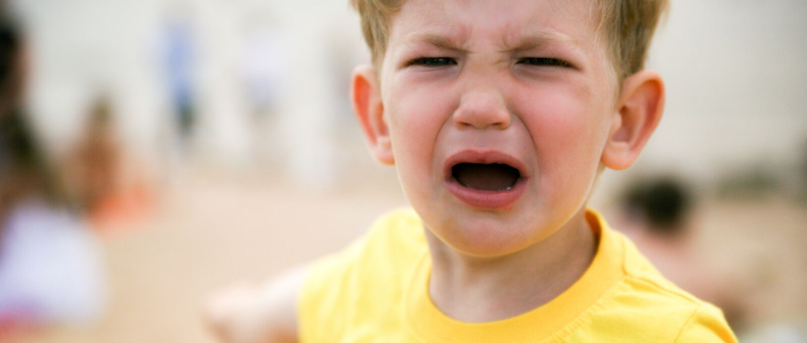 Child crying who needs an emotion coach to help handle his feelings