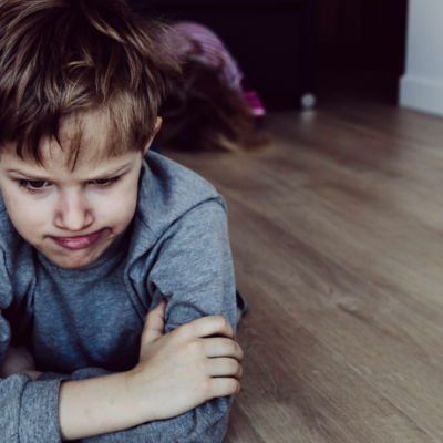 Child tantrumming stressed on floor