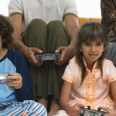 Kids enjoying screen time with their parents