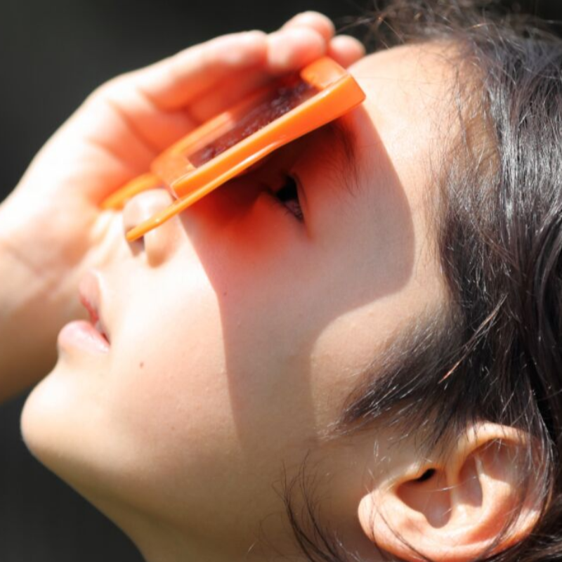 Child experiencing gratitude by looking at something through a new lens