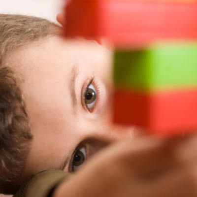 Child playing with legos demonstrating that play builds executive function
