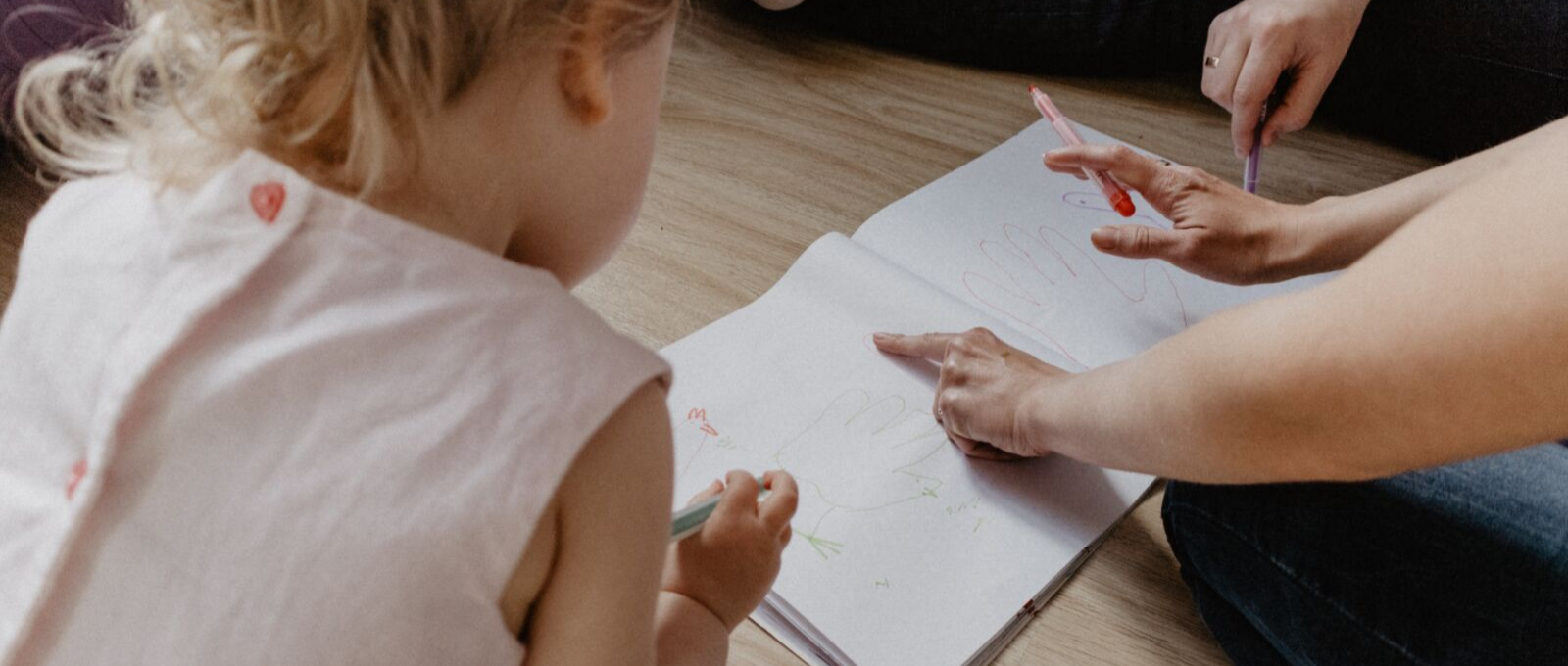Parenting raising writer by playing and drawing with them on floor