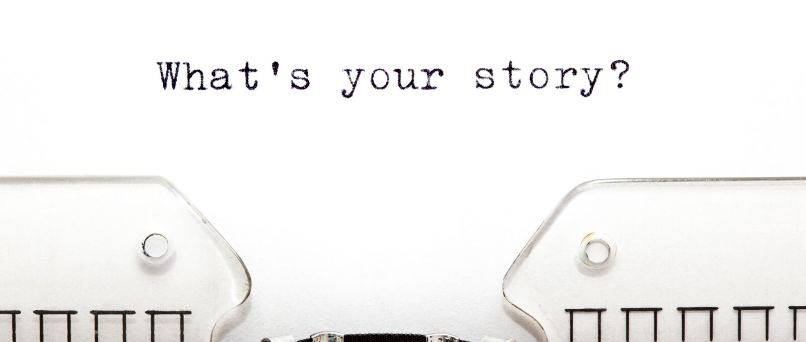 """A typewriter with a piece of paper that says """"What's your story?"""""""